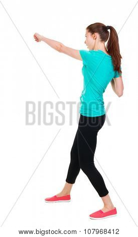 skinny woman funny fights waving his arms and legs. Rear view people collection.  backside view of person.  Isolated over white background. Sportswoman in tights slap in the face with his fist.