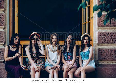 Five beautiful young girls relaxing