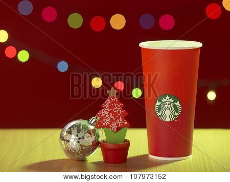 Kuala Lumpur -Malaysia,November 12, 2015: The new paper cup of Starbucks stores in the country for the Christmas on a red background cup. Starbucks brand is one of the world famous from US