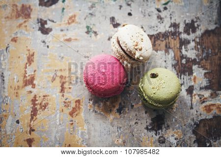 Still Life Of Three Macarons On Rustic Background