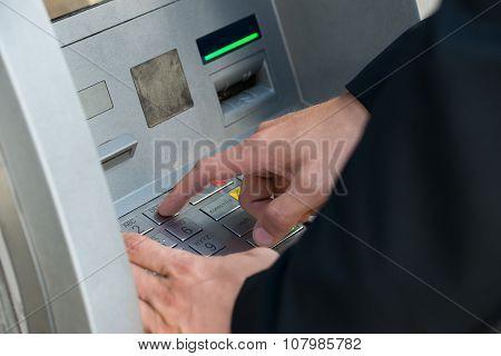 Hand Using Keypad Atm Machine