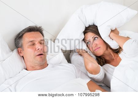 Angry Woman Trying To Sleep With Snoring Man
