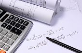 Rolls of electrical diagrams calculator and mathematical calculations for project drawings for the projects engineer jobs poster