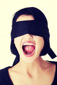 Portrait of a beautiful frighten young blindfold woman screaming poster