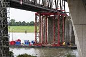 Industrial carrying platform supporting a bridge deconstruction on rhine river Germany. poster