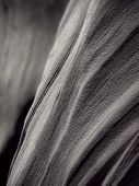 curves and drawings in black and white looking like pleats in the rocks of the antelope slot canyon near page arizona poster