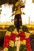 Protector Hindu Village God called as Karuppanasamy. Name is derived from protector of darkness and is usually a symbol of protection especially in agriculture areas or farmlands. poster