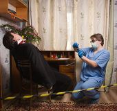 Crime scene with forensic investigating a crime on a businessman poster
