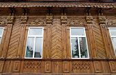 Detail of the facade of old wooden houses of the 19th century after the restoration Penza poster