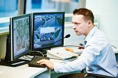 security guard officer watching video monitoring surveillance security system poster