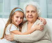 portrait of grandmother and granddaughter embracing poster