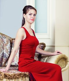 Woman In Red Dress In Luxury Interior.