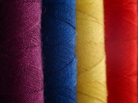 Closeup of Colourful cotton reels purple blue yellow and red