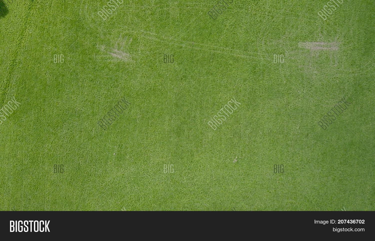 grass field aerial. Unique Aerial Aerial Photo Over Grass Field With Tyre Tracks Intended Grass Field