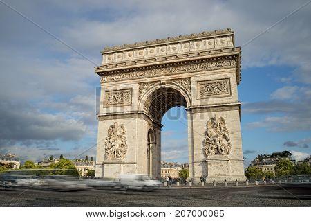 Arc de Triomphe against a blue sky taken with long exposure.