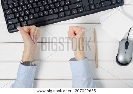 Female hands gesture all right notes for notes keyboard mouse from computer on white wooden background isolation