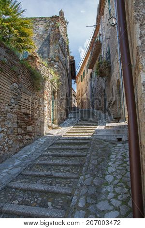 Long stone staircase in the alleyway of a country in Italy.