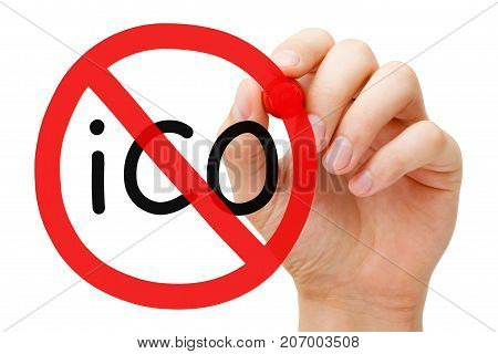 Hand drawing ICO - Initial Coin Offering prohibition sign concept with marker on transparent wipe board.