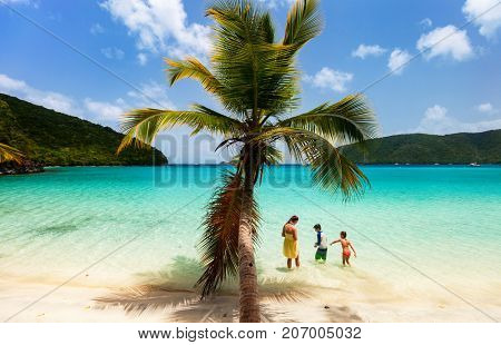 Mother and kids family at tropical beach on Caribbean island
