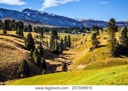 The natural landscape of the Alps di Siusi. Fabulous quiet mountain valley. The  Dolomites - World Natural Heritage. Concept pedestrian and ecotourism