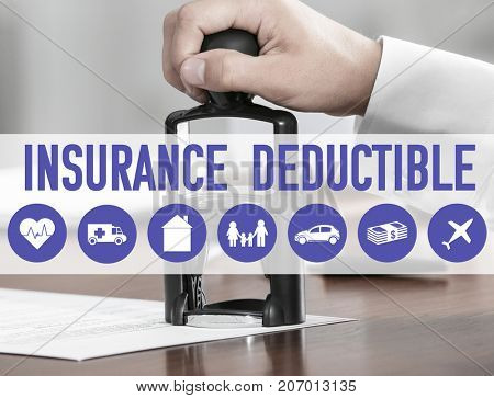 Notary public stamping document at table in office. Concept of insurance deductible