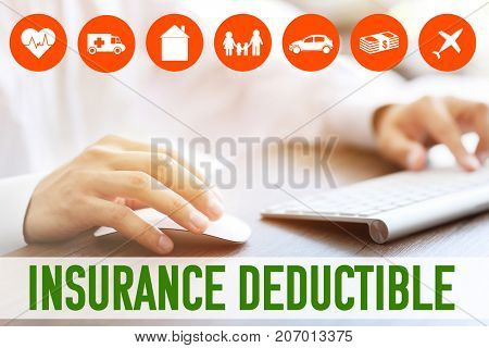 Man using computer at table. Concept of insurance deductible
