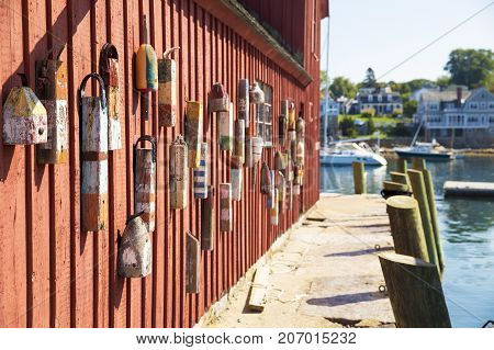 red wooden wall of the house with buoys. wall of red fishing shack known as Motif Number One in Rockport, Massachusetts, USA