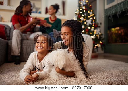 Afro-American child enjoy for Christmas eve with family at home
