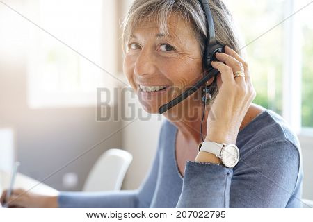 Senior sales representative working in office