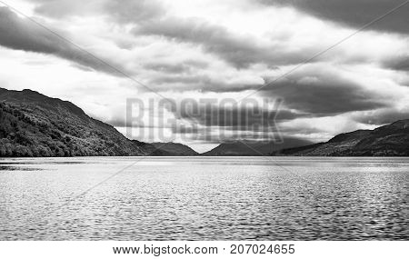 Loch Ness And Its Surrounding Mountains In Scotland
