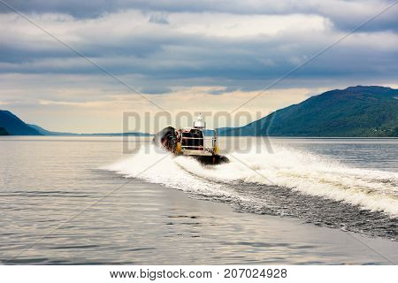 Tourists Speedboating On A Rib Boat, Loch Ness