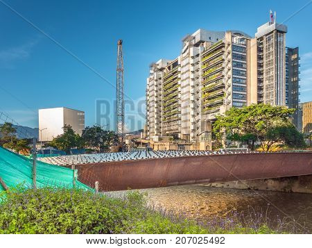Medellin Colombia. This image shows the construction site of Parques de Medellin Rio Medellin and the building called Edificio Inteligente. Piture taken on 11-Sep-2017