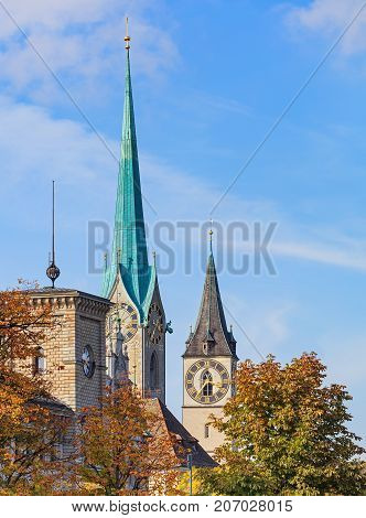 Well-known architectural landmarks of the city of Zurich: clock towers of the Fraumunster cathedral and St. Peter Church. The picture was taken in the very end of September.