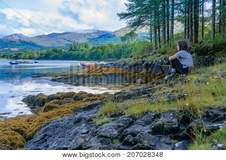 Teenage Girl Relaxing After A On Loch Creran, Scotland
