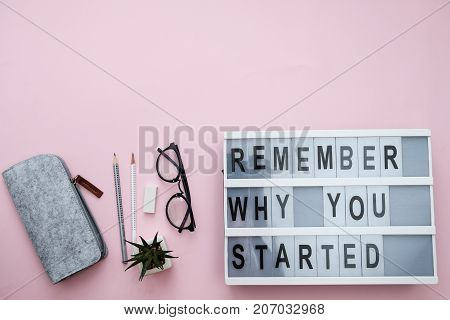 Modern Board With Text Remember Why You Started, Plant, Phone, Sheet, Pencils, Candy On A Pink Backg