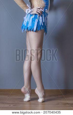 Legs gymnast. Sports training. Deformation of the foot