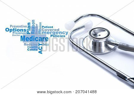 Page with Medicare word on the table with stethoscope medical concept.