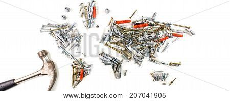 map of the world made of screws and fasteners with hammer on white background worldwide construction industry concept