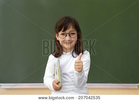 Happy Little Girl And Green Blackboard