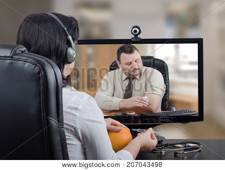 Telemedicine general practitioner teaching businessman how to do self-vaccination against influenza. Virtual female doc in headset uses grapefruit for training purpose