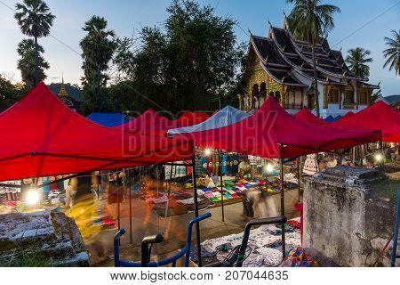 LUANG PRABANG LAOS - 9/21/2017: Activity at the popular night market in Luang Prabang Laos