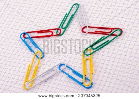 Colorful Clip Form A Star Shape On White Empty Background