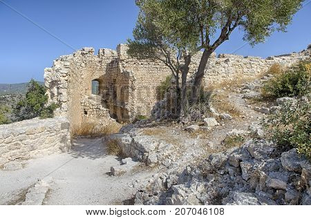 Inner courtyard of the medieval castle of Kastellos in Kritinia surrounded by strong stone walls on the island of Rhodes (Greece).