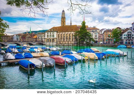 Beautiful view of historic city center of Zurich with love pad locks on the bars and famous Fraumunster Church and Munsterbucke crossing river Limmat, Canton of Zurich, Switzerland on July 10, 2017.