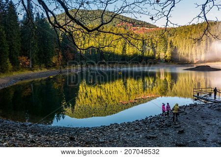 Tourists On Synevyr Lake In Autumn