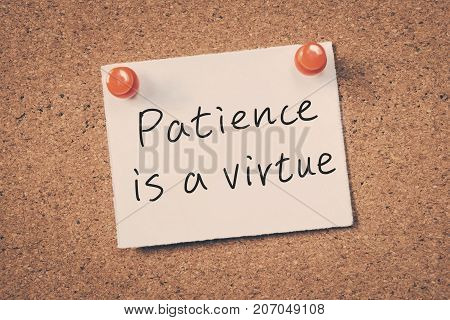Patience Is A Virtue Reminder Message On A Cork Board