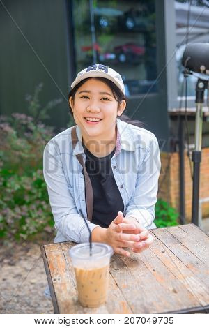 Portrait Cute Young Innocent Asian Teen Smile Sitting At The Cafe With Ice Coffee