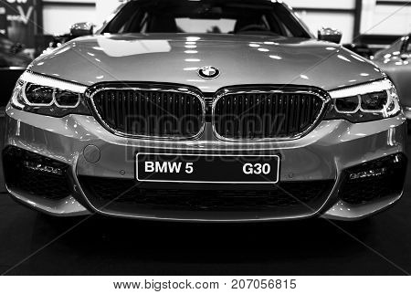 Sankt-Petersburg Russia July 21 2017: Front view of a BMW (G30) 5-series. Car exterior details. Black and white. Photo Taken at Royal Auto Show July 21