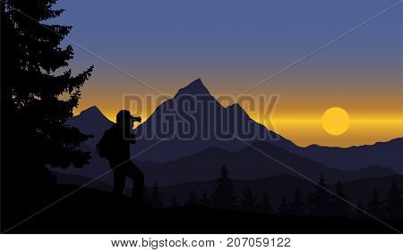 A view of a panoramic mountain landscape with forest and trees standing man strolling rising sun on blue sky - vector with space for text