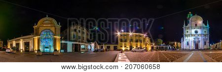 Night panorama square with Church of Madonna di Tirano, Tirano, Lombardy, Italy on July 11, 2017